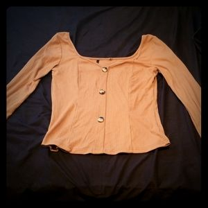 Tan long-sleeve button up with wide shoulders